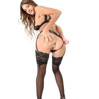 Solo model Melena Tara tucks sex toys in her sphincter and beaver in black tights