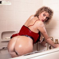 Solo model Suzanne Brecht bares her titties and ass from seductive lingerie in rest room