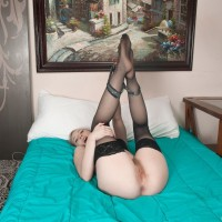 Stocking garmented blonde nubile Trillium gliding panties aside to unveil fur covered vag