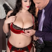 Stocking attired dark haired XXX movie star Noelle Easton freeing adorable boobies from lingerie