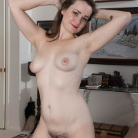 Tatted first-timer Kelly Morgan baring lil' boobs and hairy honeypot while disrobing