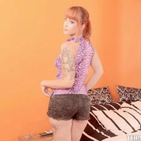 Inked redhead teen Lylian Red sliding off shorts before providing blowjob on knees