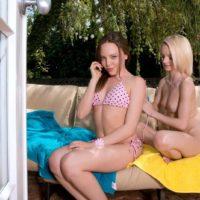 Teenage lesbians Sammy Daniels and Aubrey Starlet peel off each others bikini outdoors