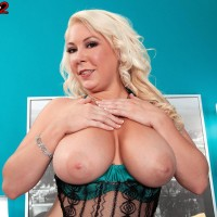 Plumper platinum-blonde solo female Morgan Page letting knockers free from wondrous lingerie in stilettos