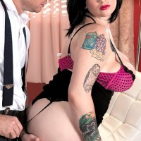 Thick brunette solo girl Scarlet LaVey flashing tats in lingerie and hosiery