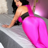 Chunky Latina girl Destiny unsheathes her enormous hooters in a skintight body-stocking and pumps