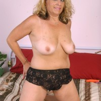 Fatty aged blond woman doing away with lingerie and panties before masturbating