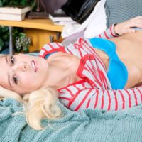 Young blond chick Halle Von uncovers her diminutive breasts garmented cowgirl boots