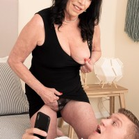 Sixty plus MILF Christina Starr entices a youthful guy while going bare-breasted in a ebony sundress