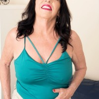 Sixty plus MILF Christina Starr uncovers her sagging tits as she gets downright naked