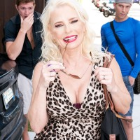 Blonde grandmother Cammille Austin wanks a pair of peckers after seducing dudes in a dress