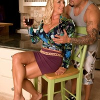 Ash-blonde MILF Anika exposes her big breasts so her dude pal can suck her erect nips