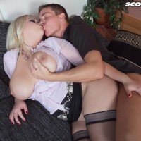 Chesty ash-blonde Katrin smooches her boy acquaintance after taking his rigid cock in hand