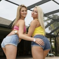 Dressed damsels Marsha May and Hope Harper model in jean cut-offs by a pool