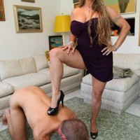 Fully-clothed girlfriend Holly Halston hikes her dress and makes her sub slurp her ass and honeypot