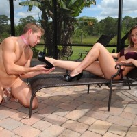 Marvelous girlfriend Callie Calypso makes her slave husband worship her feet by a pool
