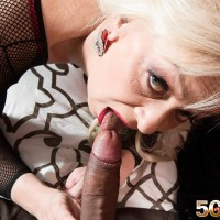 Aged yellow-haired doll Heidi strokes and licks a hefty black penis in a body-stocking