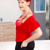 Over Sixty red-haired Caroline Hamsel plays with her breasts wearing crotchless panties
