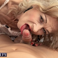 Phat yellow-haired grandmother Beata tempts a junior dude in a ebony microskirt and hose