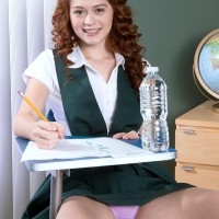 Hardly legal red-haired Alice Lime green strips nude during her college girl studies
