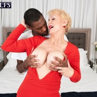 Huge-chested sandy-haired granny Seka Ebony holds a Peeping Tom's humungous ebony dick in her hand