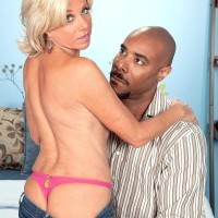 Tempting grandma Payton Hall is disrobed to a pinkish g-string by her younger black paramour