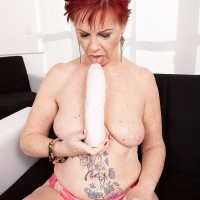 Redhead grandma Caroline Hamsel eats and deepthroats her collection of sex toys in panties
