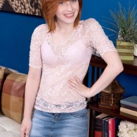 Redhead teenager Sadie Kennedy sets her diminutive titties free of her bra in amateur activity