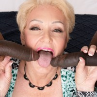 Marvelous light-haired granny Seka Black fellates on a duo of gigantic black pricks during MMF sex