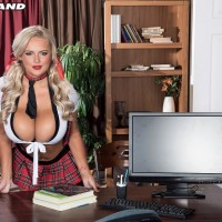 Inviting yellow-haired schoolgirl Katie Thornton pinches her nips after unsheathing her humungous boobs