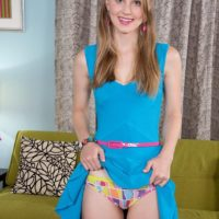 Stellar teenager Lily Rader showcases her nice panties before showing her smallish titties