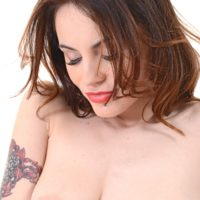 Tattooed solo female Victoria Travel fingers her hairless cunt after stripping nude