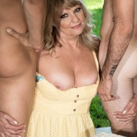 Thick Sixty plus blond Mia Magnusson tempts the gardeners outdoors for MMF sex
