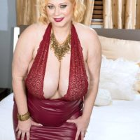 Chunky sandy-haired Samantha 38G has her giant titties toyed with by a man acquaintance