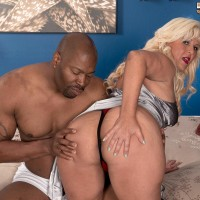 Chunky senior sandy-haired Lori Suarez bares her huge ass from silk lingerie for her ebony paramour