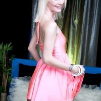 Skinny blonde teener Sammy Daniels grips a rock hard dick after a panty exhibit