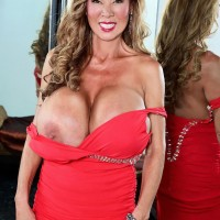 Asian solo model Minka bares her big titties from a crimson dress afore a mirror