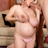BIG SEXY LADY April McKenzie bj's a huge cock after having her immense tits blown on