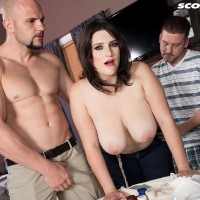 Humungous boobed chick May West has her swell nips fellated and massive butt revealed by two dudes
