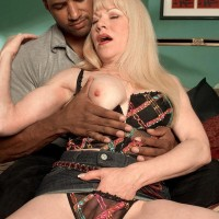 Fair-haired granny Jennifer Janes has her breasts and coochie unsheathed by her black paramour