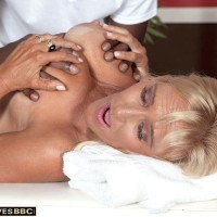 Big-titted platinum-blonde granny Brittney Snow has her tits played with by her black masseuse