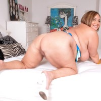 Plus size broad Kendra Mercy finger spreads her cunny before her boy licks her nipples