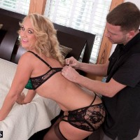 Killer ash-blonde cougar Cali Houston is liberated from beguiling lingerie on a bed by her toy stud