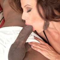 Stunning grannie Mimi Moore deep throats on a huge black dick while garbed in beguiling lingerie