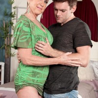 Aged woman Honey Ray sports short yellow-haired hair while milking on a young boy's cock