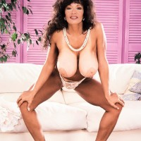 Elder XXX pornstar Chesty BriAnna sets her hefty tits free in a g-string and high-heeled shoes
