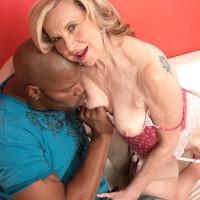 Diminutive granny Miranda Torri has her nips sucked by her younger ebony lover