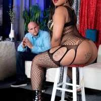 Tattooed black chick Diamond Monroe dirty dances her gigantic ass on a chair for a milky guy