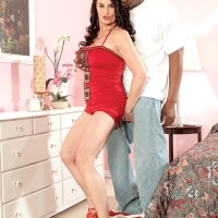 spindly grannie Rita Daniels tempts a younger black boy in a short crimson dress and heels