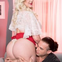 platinum ash-blonde BIG SEXY LADY Holly Wood cowers on a man's face while having her honeypot sucked